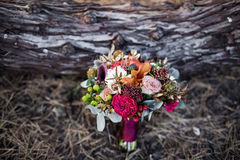 Marsala rustic wedding bouquet with red rose on wooden backgroun Stock Images