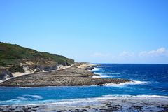 Marsalforn coastline, Gozo. View along the coastline with rocks in shallow water in the foreground, Redoubt, Marsalforn, Gozo, Malta, Europe Stock Photos