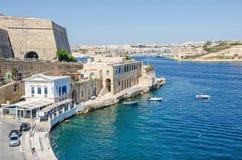 Marsamxett Harbour with the restaurant Scoglitti and Manoel Isla. Valletta, Malta - June 4, 2017: View of Marsamxett Harbour with the fortification wall of the Royalty Free Stock Image