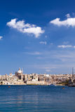 Marsamxett Harbour, Valletta, Malta. View of Valletta across the harbour from Sliema with the dome of the Carmelite Church and the tower of St Paul`s Pro Royalty Free Stock Photo