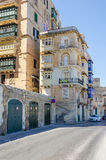 Marsamxett Street with residential buildings out of limestone. Valletta, Malta - June 4, 2017: Marsamxett Street with the typical residential buildings Stock Photography
