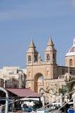 Marsaxlokk är ett traditionellt fiskeläge som lokaliseras i denöstliga delen av Malta, Royaltyfria Bilder