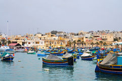 Marsaxlokk. Fishing boats, called luzzus, in the harbour of Marsaxlokk, Malta Stock Photography