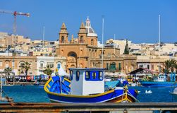 Marsaxlokk fishermen village in Malta. Traditional colorful boats at the port of Marsaxlokk. Closeup view. Marsaxlokk, Malta island. Traditional fishing boats stock image