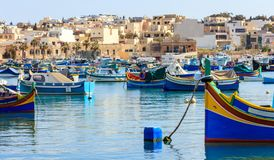 Marsaxlokk fishermen village in Malta. Traditional colorful boats at the port of Marsaxlokk. Marsaxlokk, Malta island. Traditional fishing boats luzzus with stock photo