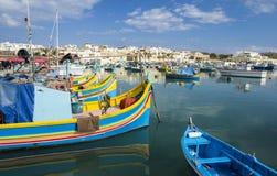 Marsaxlokk fishing harbor. Traditional fishing boats (Luzzu) at the Marsaxlokk  fishing harbor Stock Photography