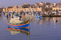 Marsaxlokk Fishing Village #4. Colorful, traditional fishing boats against the backdrop of Marsaxlokk village in the mediterranean island of Malta. See portfolio Stock Images