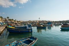 Marsaxlokk fishing village harbor with boats Stock Photo
