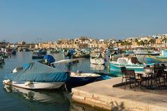 Marsaxlokk fishing village harbor with boats Royalty Free Stock Photos