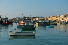 Marsaxlokk fishing village harbor with boats Royalty Free Stock Photography