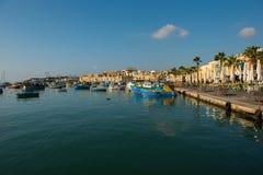 Marsaxlokk fishing village harbor with boats Stock Photos