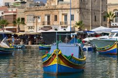 Malta, Marsaxlokk. Small but picturesque harbour to the south-east with the brightly coloured fishing boats ride at anchor, Marsaxlokk, Malta Royalty Free Stock Images