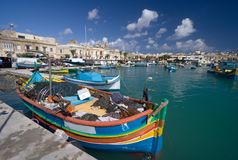 Marsaxlokk Harbor, Malta. The famous harbor in the east of Malta with lots of colorful boats Stock Photos
