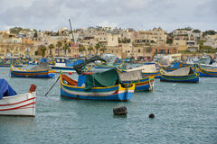 Marsaxlokk Harbor Malta. Luzzu fishing maltese boats in harbor of marsaxlokk old fishing village malta mediterranean sea Stock Image