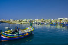 Malta, Marsaxlokk. Small but picturesque harbour to the south-east with the brightly coloured fishing boats ride at anchor, Marsaxlokk, Malta Royalty Free Stock Photos