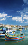 Marsaxlokk harbour and traditional mediterranean fishing boats i. N malta island Royalty Free Stock Photo