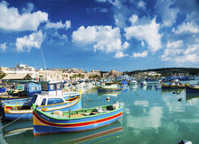 Marsaxlokk harbour and traditional mediterranean fishing boats i. N malta island Royalty Free Stock Photos