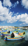 Marsaxlokk harbour and traditional mediterranean fishing boats i. N malta island Royalty Free Stock Photography