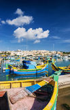 Marsaxlokk harbour and traditional mediterranean fishing boats i. N malta island Royalty Free Stock Images