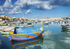Marsaxlokk harbour and traditional mediterranean fishing boats i Stock Photos
