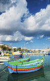 Marsaxlokk harbour and traditional mediterranean fishing boats i Stock Images