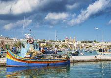 Marsaxlokk harbour and traditional mediterranean fishing boats i Royalty Free Stock Image