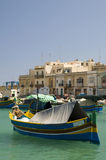Marsaxlokk luzzu village malta. Malta Marsaxlokk native fishing boat luzzus, luzzu wooden archtitecture fishing village Mediterranean sea Stock Photo