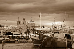 Marsaxlokk, Malta. The fishing village of Marsaxlokk in Malta in sepia Royalty Free Stock Image