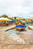 Luzzu colorful boat at Marsaxlokk Harbor on Malta Stock Photos