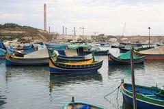 Marsaxlokk, Malta, August 2016. Bright fishing boats at anchor. royalty free stock images