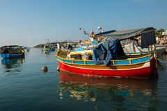 Marsaxlokk fishing village harbor with boats Stock Image