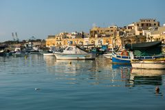 Marsaxlokk fishing village harbor with boats Stock Photography