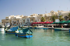 Marsaxlokk malta fishing village. Marsaxlokk malta old fishing village with ancient architecture and luzzu classic fishing boats in harbor mediterranean sea Royalty Free Stock Images