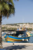 Marsaxlokk malta fishing village luzzu boat. Marsaxlokk malta old fishing village with ancient architecture and luzzu classic fishing boats in harbor Royalty Free Stock Photography