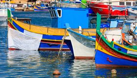 Marsaxlokk fishermen village in Malta. Traditional colorful boats at the port of Marsaxlokk. Closeup view. Marsaxlokk, Malta island. Traditional fishing boats royalty free stock photos