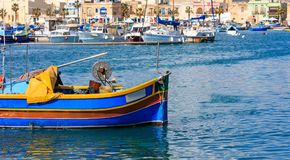 Marsaxlokk fishermen village in Malta. Traditional colorful boats at the port of Marsaxlokk. Closeup view. Marsaxlokk, Malta island. Traditional fishing boats royalty free stock images
