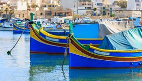 Marsaxlokk fishermen village in Malta. Traditional colorful boats at the port of Marsaxlokk. Closeup view. Marsaxlokk, Malta island. Traditional fishing boats Stock Images