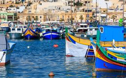 Marsaxlokk fishermen village in Malta. Traditional colorful boats at the port of Marsaxlokk. Marsaxlokk, Malta island. Traditional fishing boats luzzus with stock image