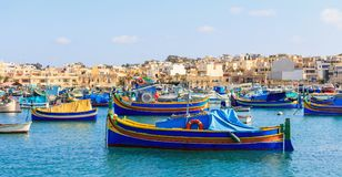 Marsaxlokk fishermen village in Malta. Traditional colorful boats at the port of Marsaxlokk. Marsaxlokk, Malta island. Traditional fishing boats luzzus with royalty free stock photography