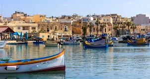 Marsaxlokk fishermen village in Malta. Traditional colorful boats at the port of Marsaxlokk. Marsaxlokk, Malta island. Traditional fishing boats luzzus with royalty free stock photos