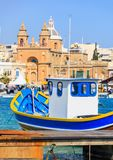 Marsaxlokk fishermen village in Malta. Traditional colorful boats at the port of Marsaxlokk. Closeup view. Marsaxlokk, Malta island. Traditional fishing boats stock photography