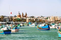 Marsaxlokk, Malta - March 31, 2018:  Famous multicolored fisherm. Marsaxlokk, Malta - March 31, 2018: Famous multicolored fisherman`s boats in Marsaxlokk Royalty Free Stock Photos