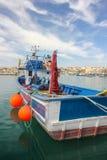 Fishing boat in port in fishing village Marsaxlokk stock photos