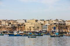 Marsaxlokk, Malta - May 2018: Panoramic view of fishing village with traditional eyed boats luzzu stock photos