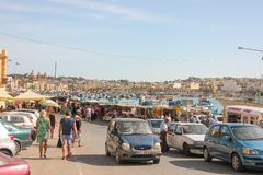Marsaxlokk, Malta - May 2018: People walking on traditional sunday fishmarket stock images