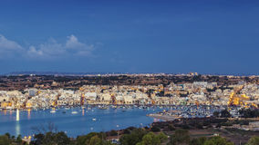 Marsaxlokk, Malta - Panoramic skyline view of Marsaxlokk. The traditional fisherman village of Malta at sunrise with blue sky and beautiful clouds Stock Photo