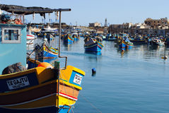 Marsaxlokk, Malta. Traditional fishing boats in Marsaxlokk, a fishing village located in the south-eastern part of Malta, with a population of 3,277 people Royalty Free Stock Photography