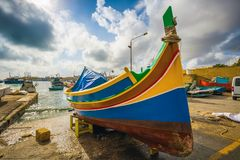 Marsaxlokk, Malta - Traditional Luzzu fisherboat at the famous market of Marsaxlokk Stock Photography