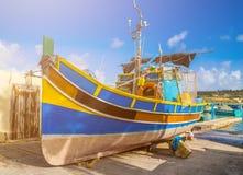 Marsaxlokk, Malta - Traditional Luzzu fisherboat at the famous market of Marsaxlokk. On a sunny summer day Royalty Free Stock Photo