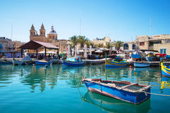 Marsaxlokk market with traditional colorful fishing boats, Malta. Iconic Maltese boats at Marsaxlokk, Malta Royalty Free Stock Photos